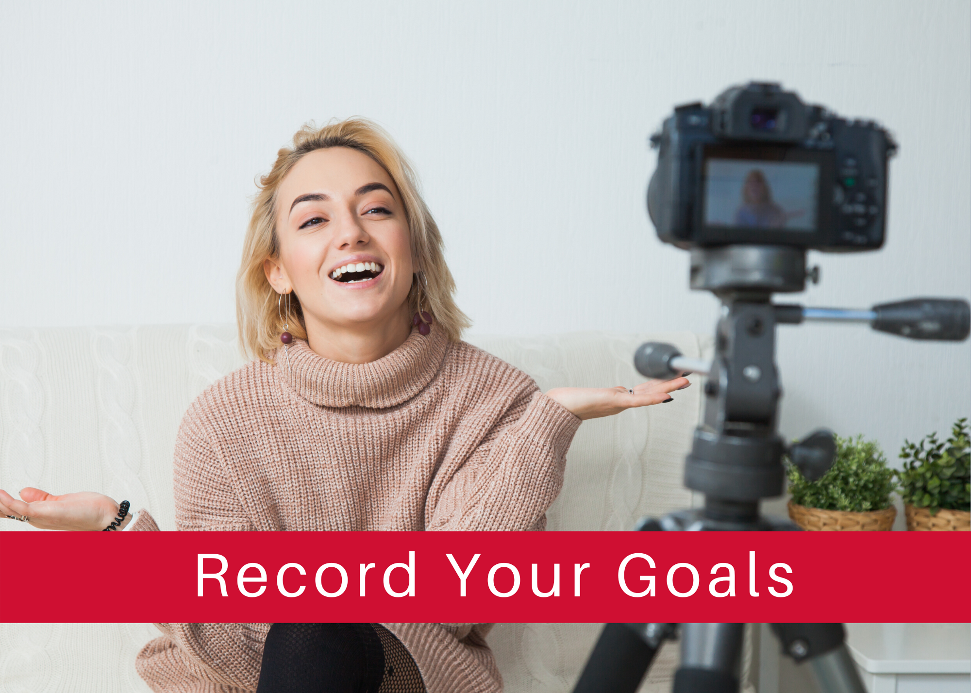 record your goals - woman with video camera
